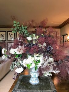 "Don't be afraid to experiment - some of the best blooms and foliage are right in your backyard. Kevin made this arrangement using cotinus, the smoke bush – like puffy clouds of ""smoke""."