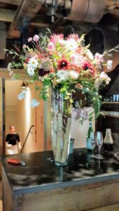 The entrance of the restaurant is upstairs. Here is a vase of freshly picked flowers. Each of Erin's employees has a specialty - including one that arranges all the flowers for the restaurant.
