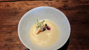 This is lobster with smoked ricotta and chilled corn soup.