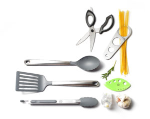 Here are some of my redesigned kitchen tools, including kitchen shears, pasta measurer, herb stripper, garlic zoom, a nylon head spoon, a nylon head slotted turner, and silicone-tip tongs.