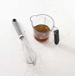 Here is my nylon-head whisk and my Martha Stewart Collection comfort-grip handle measuring cup.