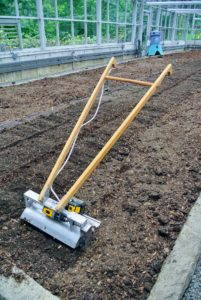 This is a lightweight tiller designed to create perfect tilth within the top two inches of the bed. It also chops up the roots of the previous crop. It was conceptualized by Eliot Coleman.
