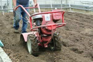 Only rototill when the ground is moist, but not wet - the soil should still crumble when picked up.