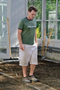 Next, Ryan walks along the twine to create the center footpath.