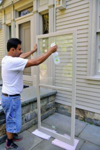 We always clean storm windows and doors before installing them - dust can always accumulate while they are in storage during the off seasons.