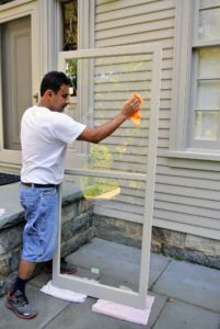 Then Carlos goes over the window again with a microfiber or lint-free cloth to prevent streaks.