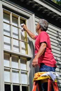 Then, Fernando wipes the vinegar-water solution around the entire window with a damp washcloth, making sure to get into the corners.