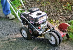This is such a handy tool – it is my Little Wonder gas powered edger – a single purpose machine used to make good, crisp lines along the edges of garden beds and lawns.