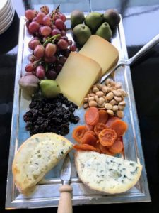 And here is a tasty cheese plate with pasteurized cheeses, dried fruits, nuts and fresh grapes.