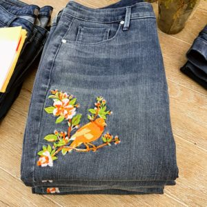 My Canary Embroidered Girlfriend Jeans are looser than my Ankle Jeans - thy have a more relaxed fit. These jeans look great rolled up or left down.