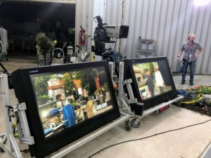 There are many monitors around the set, so the crew can always see what is happening.