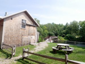 The Lost Kitchen is housed in this restored 19th century mill. At its peak, the mill processed more than five-thousand bushels of grain per year. On the right is a bridge that crosses the water below.