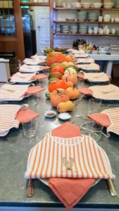 """The table in my Skylands kitchen gets so much use. Cheryl and Gretchen set a beautiful fall table complete with the Skylands lobster bibs. My """"Great Wall of China"""" can be seen in the back."""