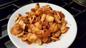 Using garlic chips instead of chopped garlic is a nice switch. We cooked them until they were golden brown - about 15 minutes. Once they are cooked, they are drained of all the oil.