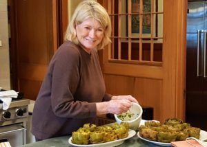 Here I am filling the artichokes before they are cooked.