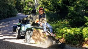 To help the process, Mike and Wendy go over the road in our all-terrain-vehicle with a special attachment that brushes the gravel like a broom.