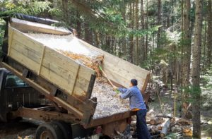 And then the wood chips are unloaded and spread across each 12-foot wide section of carriage road.