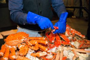 Crab legs were cracked and shelled for visitors to sample. (Photo by Ester Segretto)