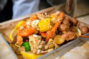 And, of course, every table enjoyed delicious Alaskan Crab Boil made by all the chefs. (Photo by Ester Segretto)
