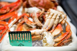 The Dungeness crab, is a species of crab that inhabits eelgrass beds and water bottoms on the west coast of North America. It typically grows to nearly eight-inches across and is a popular seafood prized for its sweet and tender flesh. Its common name comes from the port of Dungeness, Washington. (Photo by Ester Segretto)
