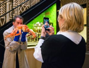 Here, the event's photographer, Ester Segretto, is taking a photograph of me taking a photograph of Kevin holding an Alaska king crab. (Photo by Ester Segretto)