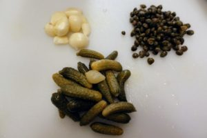 The stuffing includes garlic, capers and cornichons - small French sour pickles made with mini gherkin cucumbers, which are one to two inches in length and harvested before reaching full maturity for an extra-tart bite.