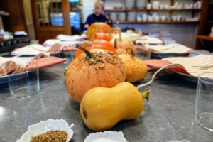 Cheryl and Gretchen created a centerpiece using pumpkins and squash grown right here at Skylands.