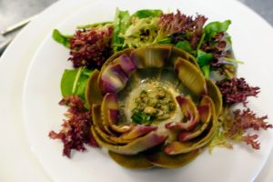 The delicious salad with stuffed artichoke - plated and ready to eat.