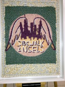 Marisol and Rob Thomas made this candy mosaic. It is the logo for their charity, Sidewalk Angels - a not-for-profit foundation focused on animal advocacy.