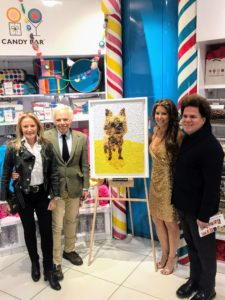 And here is Dylan joined by her parents, Ricky and Ralph Lauren, and Romero Britto, standing next to Ricky and Ralph's candy mosaic of their dog.