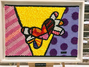 This candy mosaic is by neo-pop artist, Romero Britto. It was made using M&Ms, jelly beans, chocolate covered sunflower seeds, Gummy Bears, Pearls, and Hot Tamales.