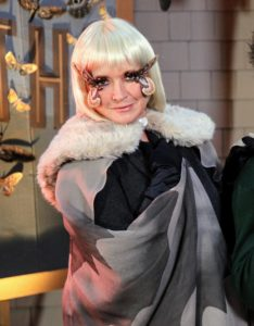 """Here I am as """"Motha"""" from our 2011 Halloween special issue - with my platinum-blonde bob wig, and flirty feathered lashes."""