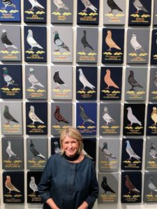 And here I am in front of the large embroidery art piece. I hope this inspires you to appreciate the pigeons that you see flying around your community. Please visit the exhibit if you're in the area - it runs through October 21st.