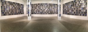 "This is a panorama of the piece titled 'The Armies of the Night'. It includes 1000 hand-painted and embroidered portraits of pigeons from the ""Fly by Night"" fleet installed around the circumference of the gallery's sky lit walls. (Photo by Alex McClure)"