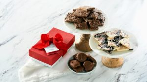 And the holidays wouldn't be complete with some of my delicious chocolates. I am offering these chocolate assortment gift boxes - sea salt toffee bark, peppermint bark and pecan nut clusters.