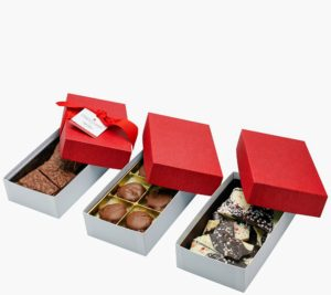 These chocolates arrive in a two-pound collection of sweet and salty chocolates nestled in ready for gifting red boxes - each tied with a red ribbon and tag.
