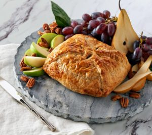 This brie en croute is sure to be a big hit. Made with a puffed pastry, baked until all the cheese is deliciously melty and filled with dried fruits and nuts.