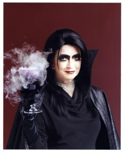 """This is """"Bad Martha"""" - part of a special 2007 holiday issue featuring 150 """"bad things"""" such as ghoulish get-ups, scary pumpkins, and spooky party ideas. My """"Glampire"""" cape was made from black silk woven with metallic threads. (Photo by Craig Cutler)"""