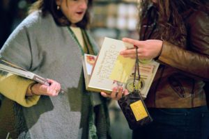 This guest was already perusing the pages for recipes. As guests got closer to my signing table, they were given a sticky-note, so they could write the name of the person receiving the book - I always try to personalize the books I sign. (Photo by Katie Hennessey)