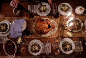 """This submission is from designer, Danielle Malin. """"Here's our table set for six with mixed-matched vintage china with gold trim, a Martha Stewart Macy's collection pumpkin and a local farm bred turkey."""""""