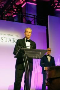 Terry Lundgren, executive chairman of Macy's, was also among the evening's honorees. Terry received the Humanitarian Award. He spoke about human connection and the hard work of those in other countries who make beautiful handmade products for retailers. Designer, Tommy Hilfiger, on the left, presented the award to Terry.