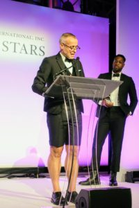 Designer Thom Browne was given the 2017 Fashion Star trophy. Professional basketball player, Dwyane Wade, who is seen behind him, presented the award.