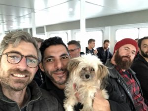 """This is our director of financial planning and analysis finance, Dana Spitler. This year, he enjoyed a """"Friendsgiving"""" on Fire Island. Dana, his husband, Wissam, and their dog, Butch, along with their friend, Will, took the ferry since there are no roads on Fire Island."""
