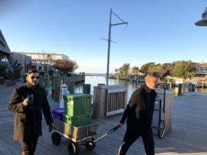 """This is Dana's friend, Bobby, and Wissam. Dana and Wissam cooked all the food at their home and then went to another house to eat. """"We had to pack everything up in a wagon to move the food. It was a very cold walk."""""""