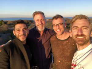 """Here's a nice photo of Wissam, Matthew, Bobby, and Dana. """"Here we are on the roof deck of our friend Matthew's house at sunset."""""""