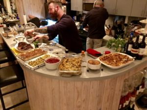 """""""And here is Will putting the last touches on the buffet. The mac and cheese, and the stuffing, were both Martha Stewart recipes."""""""