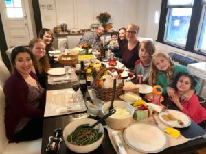 """Here is a photo from our Human Resources director, Erin Gray. She enjoyed her feast with Paola from Mexico, Stephanie from Austria, her husband, Jorge, daughter, Sydney, mother-in-law from Spain, Lourdes, sister Sierra, nephew Sam, niece Lilly, and her other daughter, Dylan. """"It was our Au Pair, Paola's, first Thanksgiving! She is from San Louis Potosi, Mexico. It was quite the global affair."""""""