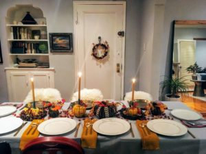 """From Deputy Food Editor, Greg Lofts - """"my boyfriend, EJ, and I, hosted for the first time this year in our little apartment. We didn't like the way the wooden candle holders looked on the table so at the last moment I attached the candles to carnival squashes instead to make them feel more festive. No food shots because I was too busy hosting and setting up the buffet to stop and take pictures."""""""