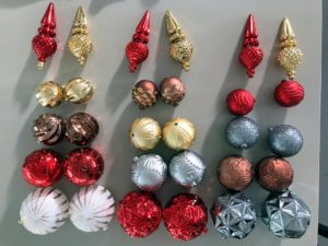 These are the Martha Stewart Living Pepperberry Lane ornaments. They come in various shapes, sizes and designs. These ornaments are made of durable plastic with a glass-like finish. They work great for the snowflake.