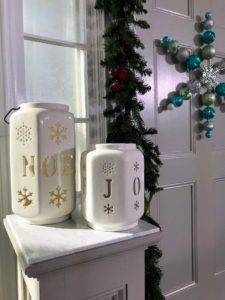 "Also in my collection at The Home Depot - these festive luminaries. The taller one is 12-inches and features the word ""NOEL"" inscribed on the outside. The smaller one is an eight-inch white luminary inscribed with the word ""JOY"". They also come in red."